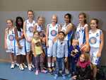 """We went to see """"C's"""" basketball game and the team decided Monty must be their mascot. The big girls are on the team  and the younger children are siblings. Look who won the much vied for privilege of holding Monty! Unfortunately our side didn't win. But Monty didn't care. He had all these beautiful young Swedish girls playing for him! The young girl in the pink scarf is """"C's"""" sister. They all really adore Monty."""